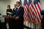 U.S. Speaker of the House Rep. John Boehner (R-OH) (R) speaks as House Majority Leader Rep. Kevin McCarthy (R-CA) (2nd L) and Rep. Cathy McMorris Rodgers (R-WA) (L) listen during a news briefing after a House Republican Caucus meeting October 27, 2015 at the Capitol in Washington, DC. Congressional leaders had reached to an agreement with the White House to raise domestic and defense spending and lift the debt limit until March 2017.