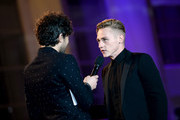 Alex Zane interviews Ben Hardy at the World Premiere of 'Bohemian Rhapsody' at SSE Arena Wembley on October 23, 2018 in London, England.