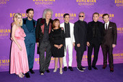 (L-R) Lucy Boynton, Gwilym Lee, Brian May, Kashmira Cooke, Rami Malek, Roger Taylor, Ben Hardy and Joe Mazzello attend the World Premiere of 'Bohemian Rhapsody' at SSE Arena Wembley on October 23, 2018 in London, England.