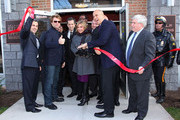 (L-R) North Ward Councilman Anibal Ramos, Jr., musician Jon Bon Jovi, designer Kenneth Cole, HELP USA Chairman Maria Cuomo Cole, City of Newark Mayor Cory Booker, and HELP USA President Laurence Belinsky cut the ribbon at the opening of affordable housing funded through Bon Jovi's JBJ Soul Foundation on December 8, 2009 in Newark, New Jersey.