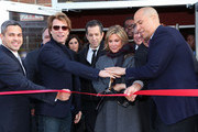 (L-R) North Ward Councilman Anibal Ramos, Jr., musician Jon Bon Jovi, designer Kenneth Cole, HELP USA Chairman Maria Cuomo Cole and City of Newark Mayor Cory Booker, cut the ribbon at the opening of affordable housing funded through Bon Jovi's JBJ Soul Foundation on December 8, 2009 in Newark, New Jersey.