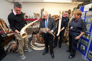 Former England cricketer Kevin Pietersen and British Foreign Secretary Boris Johnson visit the Heathrow 'dead shed' at Custom House in Heathrow, to see seized ivory and rhino horn, and other items relating to the illegal wildlife trade on May 4, 2018 in Heathrow, England.