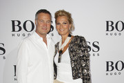 Juergen B. Harder and Franziska van Almsick arrive at the Boss Black Show during the Mercedes-Benz Fashion Week Spring/Summer 2011 on July 8, 2010 in Berlin, Germany.