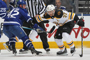 Patrice Bergeron #37 of the Boston Bruins skates against Tyler Bozak #42 of the Toronto Maple Leafs in Game Three of the Eastern Conference First Round during the 2018 Stanley Cup Play-offs at the Air Canada Centre on April 16, 2018 in Toronto, Ontario, Canada. The Maple Leafs defeated the Bruins 4-2. (Photo by Claus Andersen/Getty Images) *** Local Caption *** Patrice Bergeron; Tyler Bozak