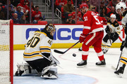 Tuukka Rask #40 of the Boston Bruins makes a second period save on a shot by Frans Nielsen #51 of the Detroit Red Wings at Little Caesars Arena on February 6, 2018 in Detroit, Michigan.