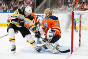 Goaltender Cam Talbot #33 of the Edmonton Oilers makes a save against Brad Marchand #63 of the Boston Bruins at Rogers Place on October 18, 2018 in Edmonton, Canada.