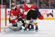 Goaltender Roberto Luongo #1 defends the next as Jared McCann #90 of the Florida Panthers checks Noel Acciari #55 of the Boston Bruins at the BB&T Center on April 5, 2018 in Sunrise, Florida. The Panthers defeated the Bruins 3-2. (Photo by Joel Auerbach/Getty Images) *** Local Caption *** Noel Acciari;Roberto Luongo;Jared McCann