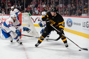 Brad Marchand #63 of the Boston Bruins looks to play the puck past Andrei Markov #79 of the Montreal Canadiens during the NHL game at the Bell Centre on January 19, 2016 in Montreal, Quebec, Canada.