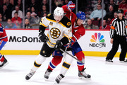 Andrei Markov #79 of the Montreal Canadiens and Carl Soderberg #34 of the Boston Bruins battle for position during the NHL game at the Bell Centre on March 12, 2014 in Montreal, Quebec, Canada.