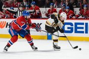 Brad Marchand #63 of the Boston Bruins skates the puck past Andrei Markov #79 of the Montreal Canadiens during the NHL game at the Bell Centre on December 9, 2015 in Montreal, Quebec, Canada.