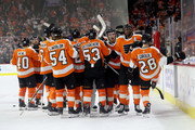 Claude Giroux #28 of the Philadelphia Flyers celebrates with teammates after scoring the game winning overtime goal against the Boston Bruins during the Flyers 4-3 win at Wells Fargo Center on April 1, 2018 in Philadelphia, Pennsylvania.