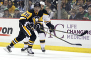 David Perron #39 of the Pittsburgh Penguins plays the puck in front of Dennis Seidenberg #44 of the Boston Bruins during the game at Consol Energy Center on March 14, 2015 in Pittsburgh, Pennsylvania.