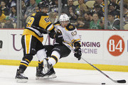 Kris Letang #58 of the Pittsburgh Penguins checks Brad Marchand #63 of the Boston Bruins in the second period during the game at Consol Energy Center on March 14, 2015 in Pittsburgh, Pennsylvania.