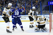 Ondrej Palat #18 of the Tampa Bay Lightning celebrates a goal by Mikhail Sergachev #98 on Tuukka Rask #40 of the Boston Bruins during Game One of the Eastern Conference Second Round  during the 2018 NHL Stanley Cup Playoffs at Amalie Arena on April 28, 2018 in Tampa, Florida.