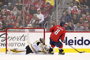 Alex Ovechkin #8 of the Washington Capitals scores the game-winning goal during a shootout on goalie Anton Khudobin #35 of the Boston Bruins at Capital One Arena on December 28, 2017 in Washington, DC.