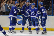 Members of the Tampa Bay Lightning, from left, Dan Girardi #5, Victor Hedman #77, Cedric Paquette #13 and Ryan Callahan #24 celebrate a goal against the Boston Bruins during the first period of the game at the Amalie Arena on April 3, 2018 in Tampa, Florida.