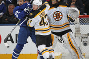 Torey Krug #47 of the Boston Bruins battles against Tomas Plekanec #19 of the Toronto Maple Leafs in Game Four of the Eastern Conference First Round in the 2018 Stanley Cup play-offs at the Air Canada Centre on April 19, 2018 in Toronto, Ontario, Canada. The Bruins defeated the Maple Leafs 3-1.