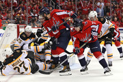 Alex Ovechkin #8 of the Washington Capitals shoots on goal as Boston Bruins defenders block the net during second period at Capital One Arena on October 3, 2018 in Washington, DC.