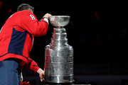 Alex Ovechkin #8 of the Washington Capitals skates with the Stanley Cup prior to watching the 2018 Stanley Cup Championship banner rise to the rafters before playing against the Boston Bruins at Capital One Arena on October 3, 2018 in Washington, DC.