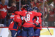 Alex Ovechkin #8 of the Washington Capitals and teammates celebrate a goal against the Boston Bruins at Capital One Arena on October 3, 2018 in Washington, DC.