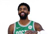 Kyrie Irving #11 poses for a photo during a photo shoot on Boston Celtics Media Day on September 24, 2018 in Canton, Massachusetts.