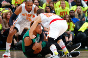 Jared Sullinger #7 of the Boston Celtics grabs a loose ball against Al Horford #15 and Kyle Korver #26 of the Atlanta Hawks in Game One of the Eastern Conference Quarterfinals during the 2016 NBA Playoffs at Philips Arena on April 16, 2016 in Atlanta, Georgia.  NOTE TO USER User expressly acknowledges and agrees that, by downloading and or using this photograph, user is consenting to the terms and conditions of the Getty Images License Agreement.