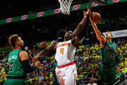 Paul Millsap #4 of the Atlanta Hawks battles for a rebound against Jared Sullinger #7, Jae Crowder #99 and R.J. Hunter #28 of the Boston Celtics in Game One of the Eastern Conference Quarterfinals during the 2016 NBA Playoffs at Philips Arena on April 16, 2016 in Atlanta, Georgia.  NOTE TO USER User expressly acknowledges and agrees that, by downloading and or using this photograph, user is consenting to the terms and conditions of the Getty Images License Agreement.