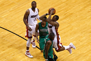 Mario Chalmers #15 of the Miami Heat attempts a shot against Mickael Pietrus #28 of the Boston Celtics in Game Two of the Eastern Conference Finals in the 2012 NBA Playoffs on May 30, 2012 at American Airlines Arena in Miami, Florida. NOTE TO USER: User expressly acknowledges and agrees that, by downloading and or using this photograph, User is consenting to the terms and conditions of the Getty Images License Agreement.