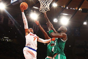 Carmelo Anthony #7 of the New York Knicks shoots against Jeff Green #8 of the Boston Celtics and Kevin Garnett #5 during Game five of the Eastern Conference Quarterfinals of the 2013 NBA Playoffs at Madison Square Garden on May 1, 2013 in New York City.  NOTE TO USER: User expressly acknowledges and agrees that, by downloading and or using this photograph, User is consenting to the terms and conditions of the Getty Images License Agreement.
