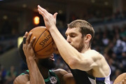 Tyler Zeller #44 of the Milwaukee Bucks gets his arm on the ball as Jaylen Brown #7 of the Boston Celtics drives during Game Four of Round One of the 2018 NBA Playoffs at the Bradley Center on April 22, 2018 in Milwaukee, Wisconsin. The Bucks defeated the Celtics 104-102. NOTE TO USER: User expressly acknowledges and agrees that, by downloading and or using this photograph, User is consenting to the terms and conditions of the Getty Images License Agreement.