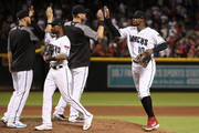 Jarrod Dyson #1 and Adam Jones #10 of the Arizona Diamondbacks high five teammates after defeating the Boston Red Sox 15-8 in the MLB game at Chase Field on April 05, 2019 in Phoenix, Arizona.