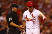 Matt Holliday #7 of the St. Louis Cardinals argues with umpire Mark Ripperger #90 after he was called out on strikes with a runners on the bases in the seventh inning against the Boston Red Sox at Busch Stadium on August 5, 2014 in St. Louis, Missouri.  The Cardinals beat the Red Sox 3-2.