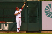 Matt Holliday #7 of the St. Louis Cardinals misplays a deep fly ball allowing the Boston Red Sox to score a run in the fourth inning at Busch Stadium on August 6, 2014 in St. Louis, Missouri.