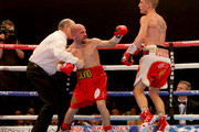 Referee Phil Edwards steps in to stop the fight between Paul Butler and Silvio Olteanu during their WBO European super flyweight title fight at the Manchester Arena on December 19, 2015 in Manchester, England.