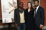"""Book author William Kamkwamba, host Angelina Jolie and director Chiwetel Ejiofor attend """"The Boy Who Harnessed The Wind"""" Special Screening at Crosby Street Hotel on February 25, 2019 in New York City."""