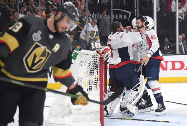 2018 NHL Stanley Cup Final - Game Five [player,college ice hockey,ice hockey position,sports gear,sports,ice hockey equipment,hockey protective equipment,ice hockey,hockey pants,team sport,braden holtby 70,tom wilson,reilly smith,five,t-mobile arena,las vegas,nhl,washington capitals,vegas golden knights,stanley cup final]