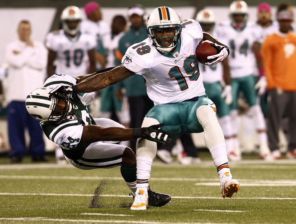 19 of the miami dolphins hits darrelle revis 24 of the new york