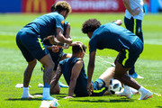 Neymar Jr and Willian of Brazil smash eggs on Philippe Coutinho of Brazil as a birthday prank during a Brazil training session ahead of the FIFA World Cup 2018 at Yug-Sport Stadium on June 12, 2018 in Sochi, Russia.