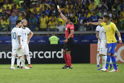 Referee Roddy Zambrano shows a yellow card to Sergio Aguero of Argentina during the Copa America Brazil 2019 Semi Final match between Brazil and Argentina at Mineirao Stadium on July 02, 2019 in Belo Horizonte, Brazil.