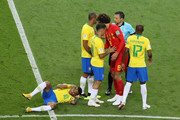 Neymar Jr of Brazil lies on the pitch while Referee Milorad Mazic talks to Marouane Fellaini of Belgium during the 2018 FIFA World Cup Russia Quarter Final match between Brazil and Belgium at Kazan Arena on July 6, 2018 in Kazan, Russia.