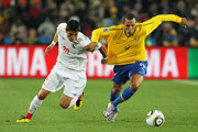 Rodrigo Millar of Chile and Luis Fabiano of Brazil tussle for the ball during the 2010 FIFA World Cup South Africa Round of Sixteen match between Brazil and Chile at Ellis Park Stadium on June 28, 2010 in Johannesburg, South Africa.