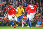 Neymar of Brazil is closed down by Pablo Hernandez, Charles Aranguiz, Gonzalo Jara and Gary Medel of Chile during the international friendly match between Brazil and Chile at the Emirates Stadium on March 29, 2015 in London, England.