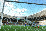 Gonzalo Jara of Chile shoots and hits the post to miss the decisive penalty against Julio Cesar of Brazil during the 2014 FIFA World Cup Brazil round of 16 match between Brazil and Chile at Estadio Mineirao on June 28, 2014 in Belo Horizonte, Brazil.