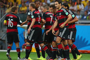 Thomas Mueller (obscured) of Germany celebrates with his team-mates (L-R) Philipp Lahm, Benedikt Hoewedes, Jerome Boateng, Bastian Schweinsteiger, Miroslav Klose and Mats Hummels of Germany after scoring the opening goal during the 2014 FIFA World Cup Brazil Semi Final match between Brazil and Germany at Estadio Mineirao on July 8, 2014 in Belo Horizonte, Brazil.