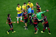 Referee Marco Rodriguez restores order after a challenge during the 2014 FIFA World Cup Brazil Semi Final match between Brazil and Germany at Estadio Mineirao on July 8, 2014 in Belo Horizonte, Brazil.