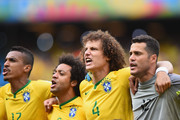 (L-R) Luiz Gustavo of Brazil, Marcelo, David Luiz and Julio Cesar sing the National Anthem before the 2014 FIFA World Cup Brazil Group A match between Brazil and Mexico at Castelao on June 17, 2014 in Fortaleza, Brazil.