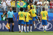 Neymar Jr of Brazil celebrates with teammates after scoring his team's first goal during the 2018 FIFA World Cup Russia Round of 16 match between Brazil and Mexico at Samara Arena on July 2, 2018 in Samara, Russia.