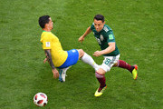 Fagner of Brazil tackles Andres Guardado of Mexico during the 2018 FIFA World Cup Russia Round of 16 match between Brazil and Mexico at Samara Arena on July 2, 2018 in Samara, Russia.