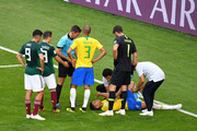 Neymar Jr of Brazil receives treatment during the 2018 FIFA World Cup Russia Round of 16 match between Brazil and Mexico at Samara Arena on July 2, 2018 in Samara, Russia.