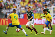 Andres Guardado of Mexico runs with the ball during the 2018 FIFA World Cup Russia Round of 16 match between Brazil and Mexico at Samara Arena on July 2, 2018 in Samara, Russia.